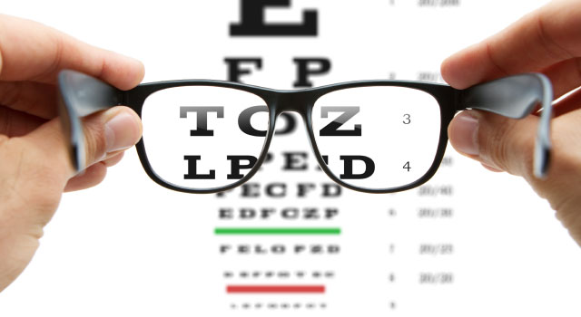 Looking at an eye chart through a pair of glasses
